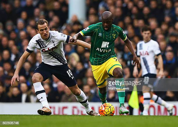 Youssouf Mulumbu of Norwich City is closed down by Harry Kane of Tottenham Hotspur during the Barclays Premier League match between Tottenham Hotspur...