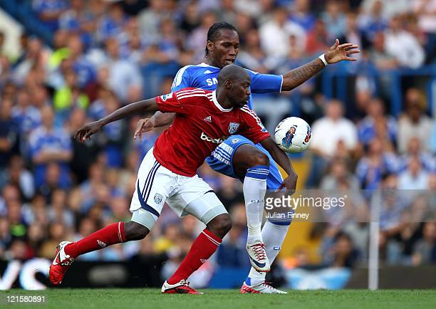 Youssouf Mulumbu of West Brom and Didier Drogba of Chelsea compete for the ball during the Barclays Premier League match between Chelsea and West...