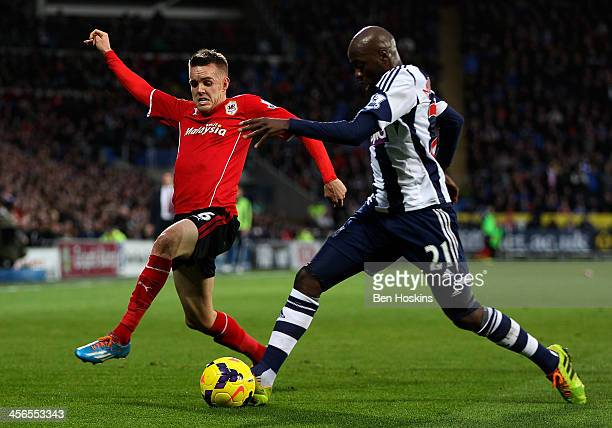 Youssouf Mulumbu of West Brom holds off pressure from Craig Noone of Cardiff during the Barclays Premier League match between Cardiff City and West...