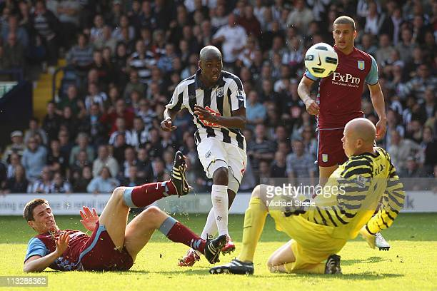 Youssouf Mulumbu of West Brom scores the winning goal as Ciaran Clark and goalkeeper Brad Friedel close in during the Barclays Premier League match...