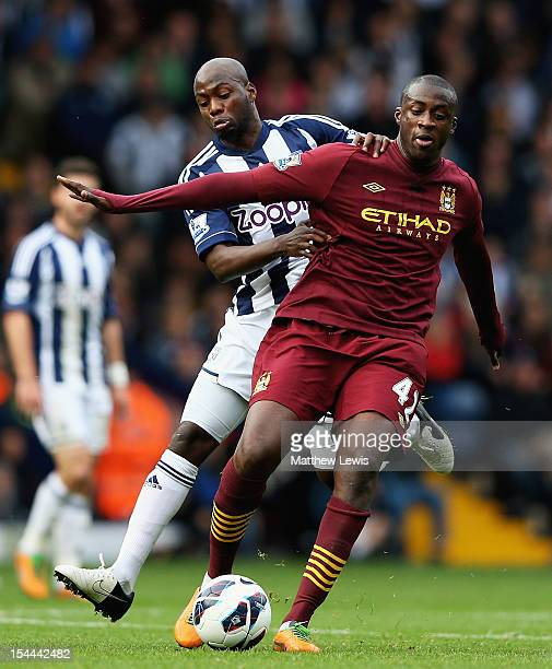 Youssouf Mulumbu of West Bromwich Albion and Yaya Toure of Manchester City challenge for the ball during the Barclays Premier League match between...