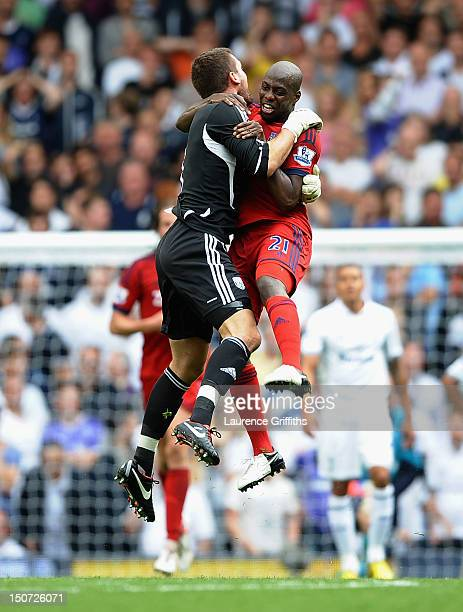 Youssouf Mulumbu of West Bromwich Albion celebrates the late goal scored by James Morrison with goalkeeper Ben Foster during the Barclays Premier...