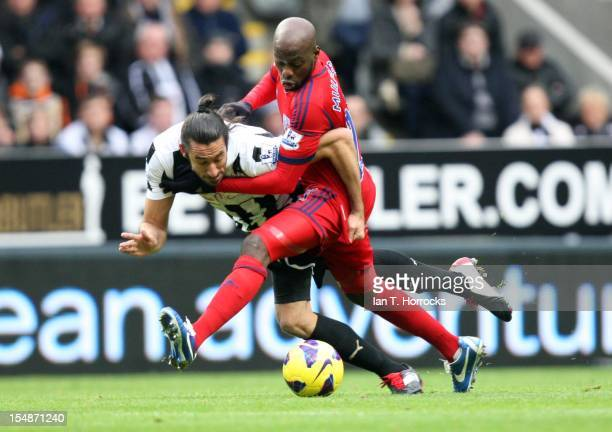 Youssouf Mulumbu of West Bromwich Albion challenges Jonas Gutierrez of Newcastle United during the Barclays Premier League match between Newcastle...