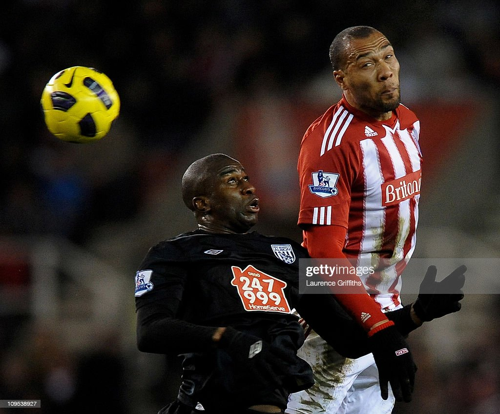 Youssouf Mulumbu of West Bromwich Albion goes up for a header with John Carew of Stoke City during the Barclays Premier League match between Stoke City and West Bromwich Albion at The Britannia Stadium on February 28, 2011 in Stoke on Trent, England.