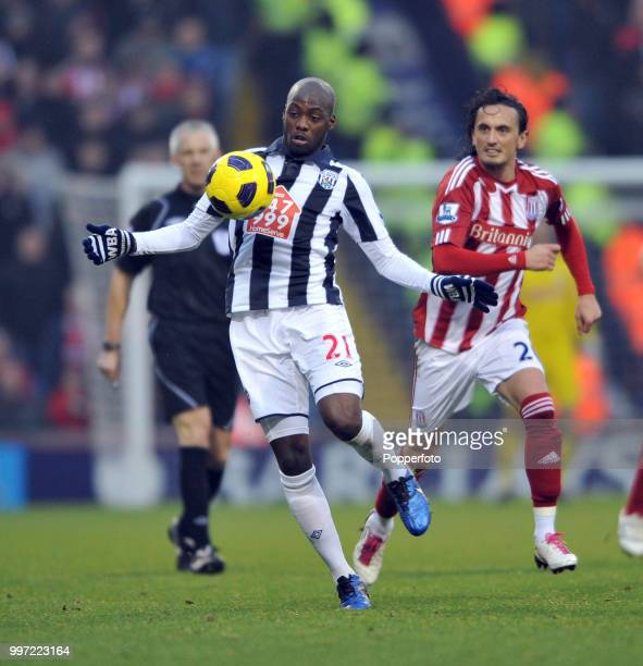 Youssouf Mulumbu of West Bromwich Albion is chased by Tuncay Sanli of Stoke City during a Barclays Premier League match at The Hawthorns on November...