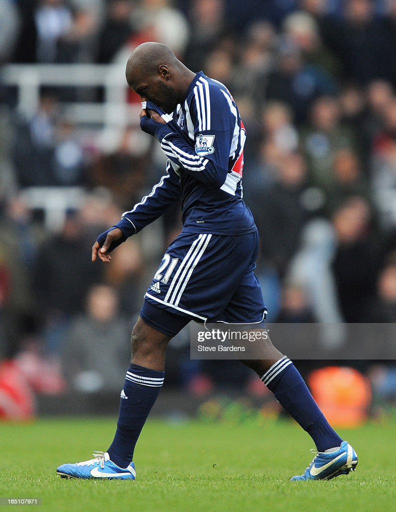 Youssouf Mulumbu of West Bromwich Albion walks off the pitch after being sent off by referee Andre Marriner during the Barclays Premier League match between West Ham United and West Bromwich Albion at the Boleyn Ground on March 30, 2013 in London, England.