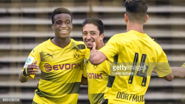 Youssoufa Moukoko celebrates his goal with Immanuel Pherai and Lucas Klantzos during the B Juniors Bundesliga match between Borussia Dortmund and FC...