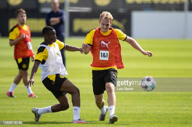 Youssoufa Moukoko challenges Julian Brandt during the first training session after the summer break on August 03 2020 in Dortmund Germany