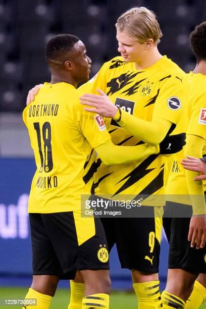 Youssoufa Moukoko of Borussia Dortmund and Erling Haaland of Borussia Dortmund celebrate after winning during the Bundesliga match between Hertha BSC...