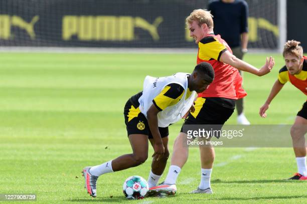 Youssoufa Moukoko of Borussia Dortmund and Julian Brandt of Borussia Dortmund battle for the ball during the first training session after the summer...
