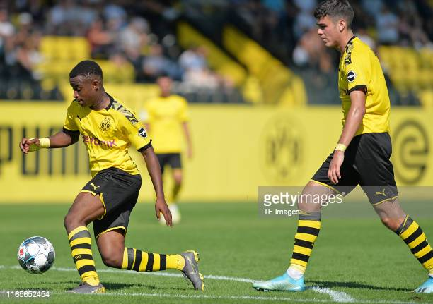 Youssoufa Moukoko of Borussia Dortmund U19 controls the ball Giovanni Reyna of Borussia Dortmund U19 looks on during the first round match of the DFB...