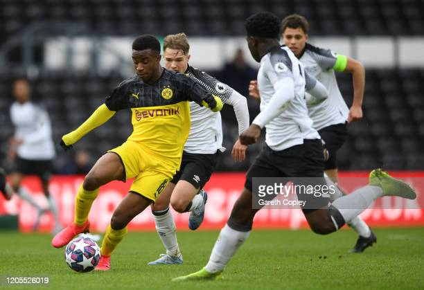 Youssoufa Moukoko of Borussia Dortmund U19 runs with the ball during the UEFA Youth League match between Derby U19 and Borussia Dortmund U19 at Pride...