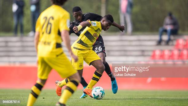 Youssoufa Moukoko of Dortmund and Abdul Fesenmeyer of Leverkusen in action during the B Juniors Bundesliga West match between Bayer Leverkusen and...