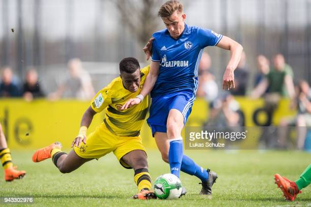 Youssoufa Moukoko of Dortmund and Leon Bachmann of Schalke in action during the B Juniors Bundesliga match between Borussia Dortmund and FC Schalke...