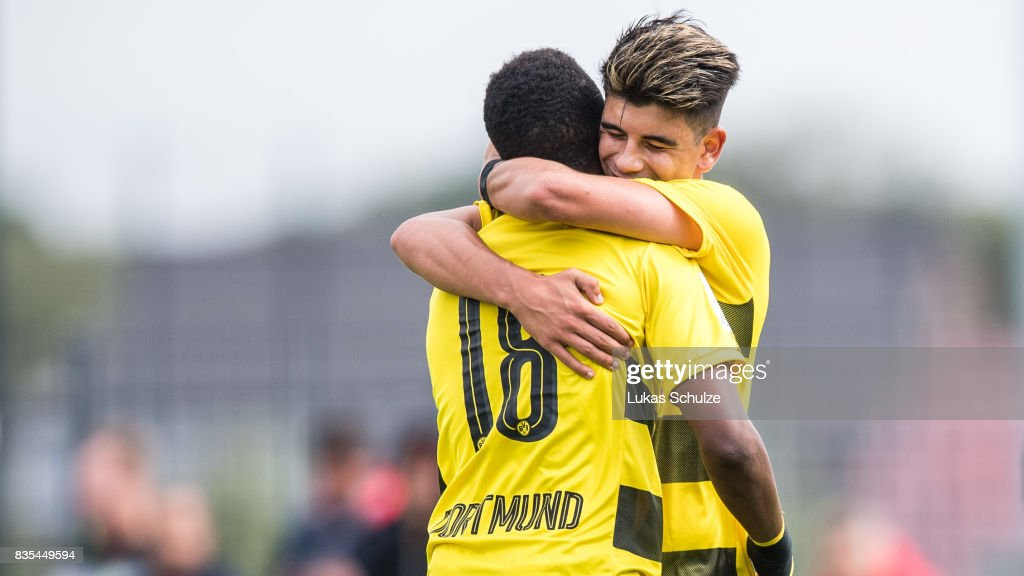 Youssoufa Moukoko (L) of Dortmund and Lucas Klantzos of Dortmund celebrate a goal during the B Juniors Bundesliga match between Borussia Dortmund and FC Viktoria Koeln on August 19, 2017 in Dortmund, Germany.