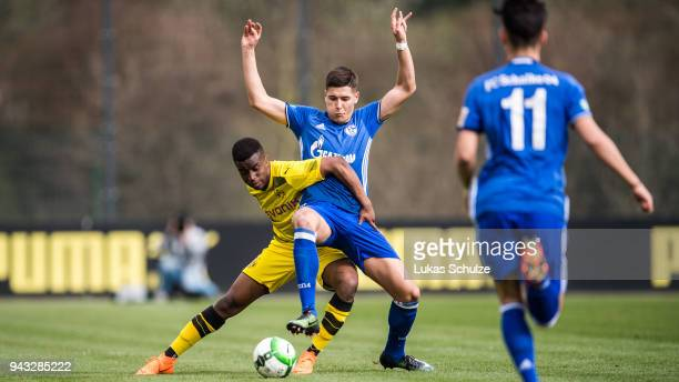 Youssoufa Moukoko of Dortmund and Sava Cestic of Schalke in action during the B Juniors Bundesliga match between Borussia Dortmund and FC Schalke 04...