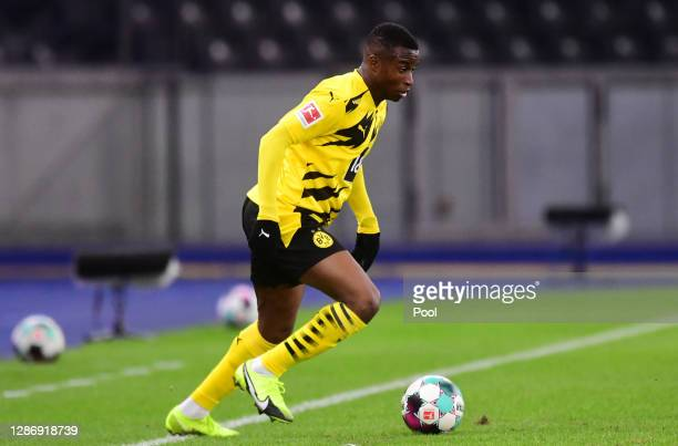 Youssoufa Moukoko of Dortmund controls the ball during the Bundesliga match between Hertha BSC and Borussia Dortmund at Olympiastadion on November...