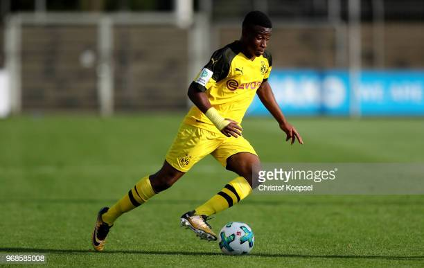 Youssoufa Moukoko of Dortmund runs with the ball during the B Juniors German Championship Semi Final first leg match match between Bayer Leverkusen...