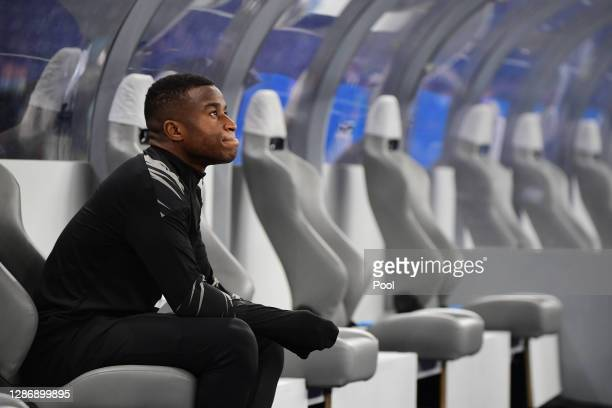 Youssoufa Moukoko of Dortmund takes a rest on the bench before warming up for the Bundesliga match between Hertha BSC and Borussia Dortmund at...
