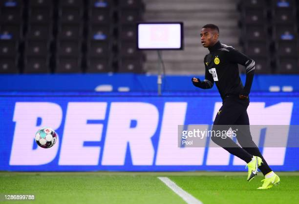 Youssoufa Moukoko of Dortmund warms up for the Bundesliga match between Hertha BSC and Borussia Dortmund at Olympiastadion on November 21, 2020 in...