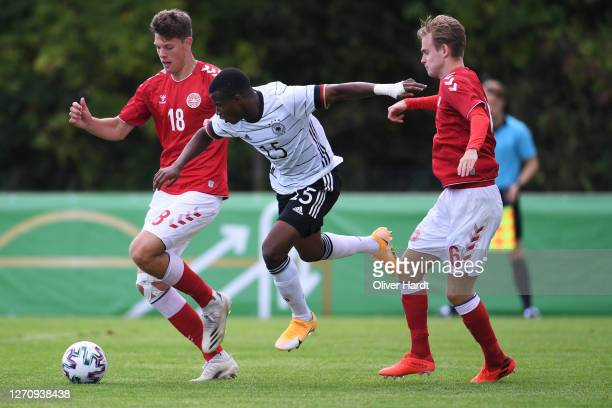 Youssoufa Moukoko of Germany competes for the ball with Tobias Anker of Denmark during the international friendly match between Germany U20 and...