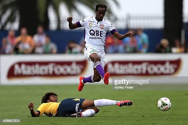 Youssouff Hersi of the Glory is tackled by Isaka Cernak of the Mariners during the round five A-League match between the Central Coast Mariners and...