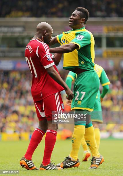Youssuf Mulumbu of West Brom argues with Alexander Tettey of Norwich City during the Barclays Premier League match between Norwich City and West...