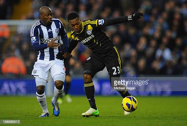 Youssuf Mulumbu of West Brom battles Daniel Sturridge of Chelsea during the Barclays Premier League match between West Bromwich Albion and Chelsea at...