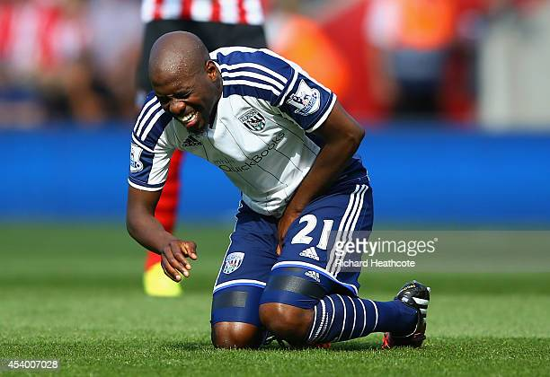 Youssuf Mulumbu of West Brom grimaces during the Barclays Premier League match between Southampton and West Bromwich Albion at St Mary's Stadium on...