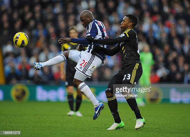 Youssuf Mulumbu of West Brom in action with Daniel Sturridge of Chelsea during the Barclays Premier League match between West Bromwich Albion and...