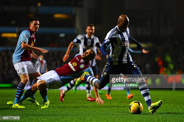 Youssuf Mulumbu of West Brom scores their third goal during the Barclays Premier League match between Aston Villa and West Bromwich Albion at Villa...
