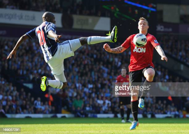 Youssuf Mulumbu of West Bromwich Albion battles with Alexander Buttner of Manchester United during the Barclays Premier League match between West...