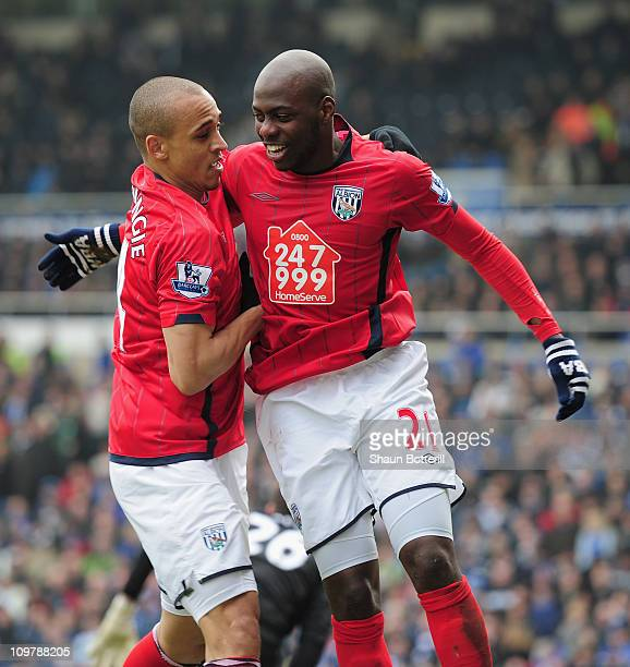 Youssuf Mulumbu of West Bromwich Albion is congratulated by team-mate Peter Odemwingie after scoring during the Barclays Premier League match between...