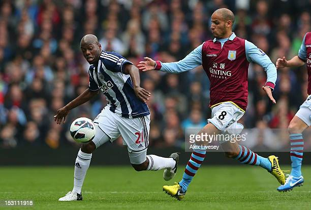 Yousuff Mulumbu of West Bromwich Albion battles for the ball with Karim El Ahmadi of Aston Villa during the Barclays Premier League match between...