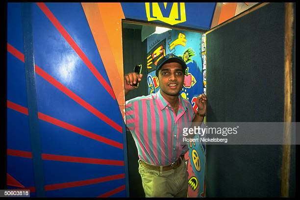 Youth acting out in Channel V music TV ad lib video booth in recorded session later aired fr Hong Kong STAR TV at record store in Bombay India