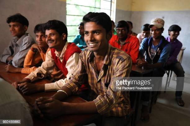 Youth ages 15 to 19 from the Mahadalit community attend a training about sexual and reproductive health at the village school In this session they...