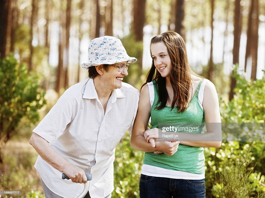 Youth and age keep company: happy granny walking with granddaughter : Stock Photo