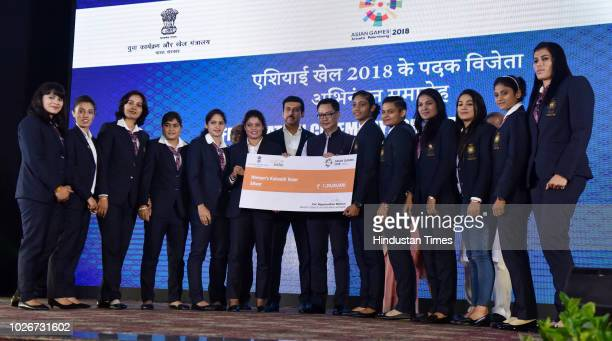 Youth and Sports Minister Rajyavardhan Rathore and Union Minister Kiren Rijiju with the Women Kabaddi team during their felicitation ceremony at...