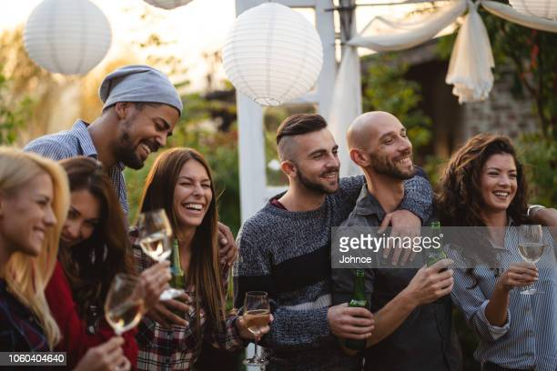youth at a social gathering in the yard - gay person stock pictures, royalty-free photos & images