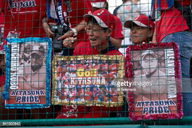 Little League World Series Japan Region fans cheering holding signs during Championship Game vs USA Southwest Region at Howard J Lamade Stadium South...