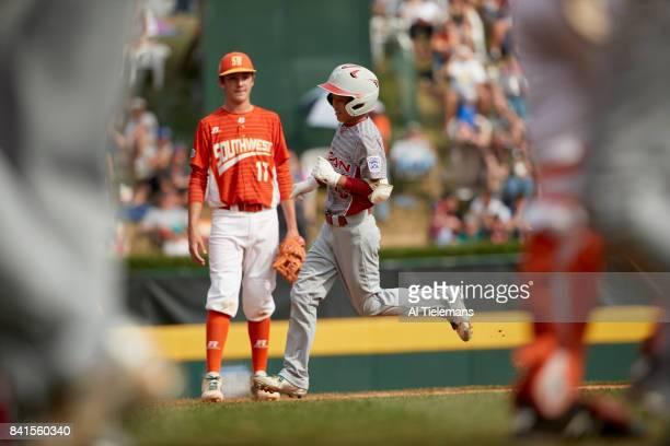 Little League World Series Japan Region Keitaro Miyahara in action rounding bases after hitting homerun vs USA Southwest Region during Championship...