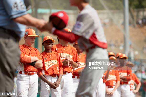 Little League World Series Japan Region player shaking hands in the foreground as USA Southwest Region look on after Championship Game at Howard J...