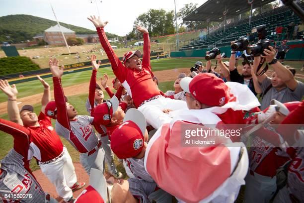 Little League World Series Japan Region team victorious hoisting manager Junnji Hidaka after defeating USA Southwest Region during Championship Game...