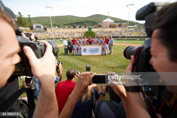 Little League World Series Japan Region team victorious posing for team photo after defeating USA Southwest Region during Championship Game at Howard...