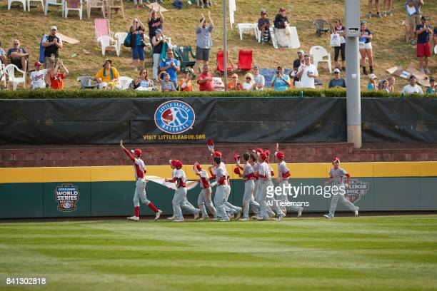 Little League World Series Japan Region team victorious taking victory lap after defeating USA Southwest Region during Championship Game at Howard J...