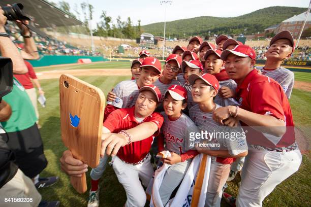 Little League World Series Japan Region team victorious taking selfies with manager Junnji Hidaka and coaches after defeating USA Southwest Region...