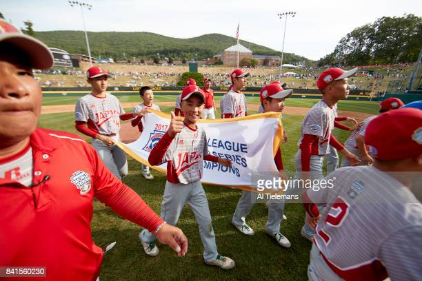 Little League World Series Japan Region team victorious taking victory lap with LLWS banner after defeating USA Southwest Region during Championship...