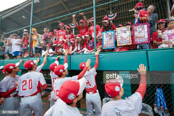 Little League World Series Japan Region team victorious waving to friends and family after defeating USA Southwest Region during Championship Game at...