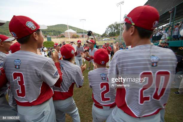 Little League World Series Japan Region team victorious celebrating with friends and family after defeating USA Southwest Region during Championship...
