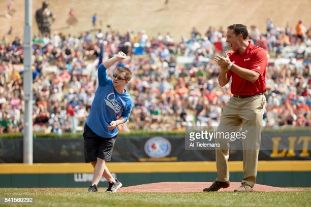 Little League World Series Little League Hall of Excellence member Champ Pederson throwing out first pitch with former MLB player and television...